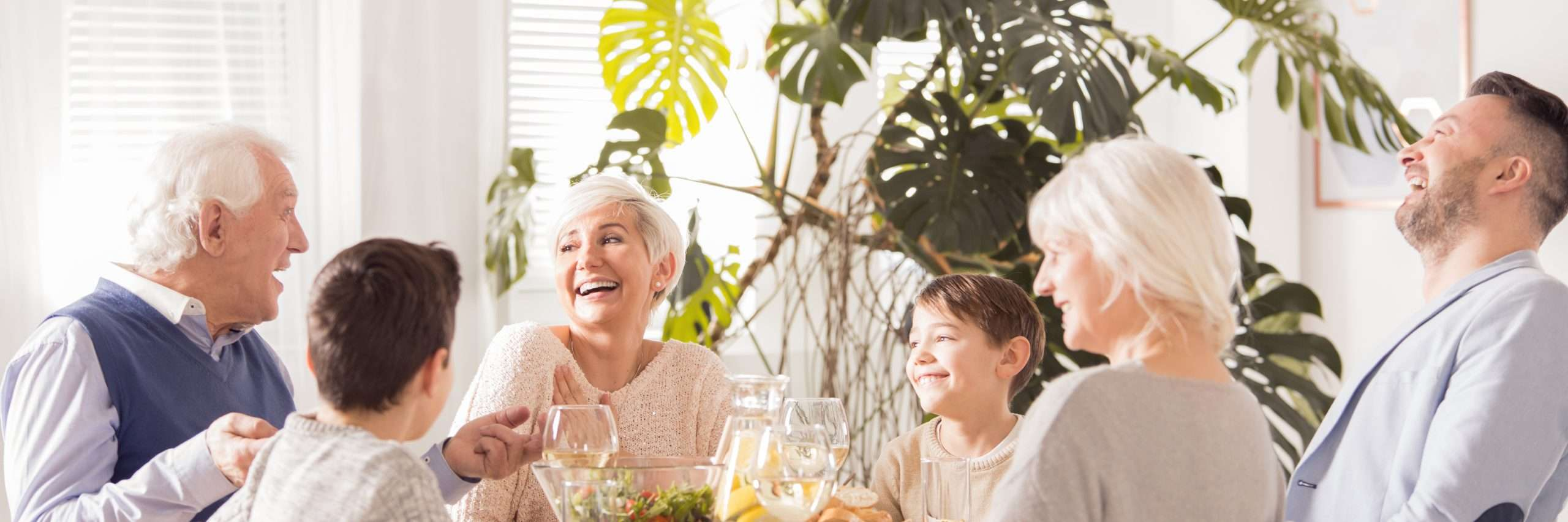 Generational Family enjoying dinner together in home